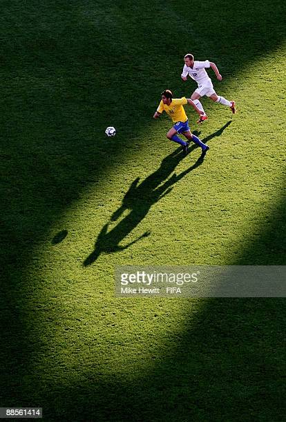 Kaka of Brazil is chased by Michael Bradley of USA during the FIFA Confederations Cup Group B match between USA and Brazil at the Loftus Versveld...