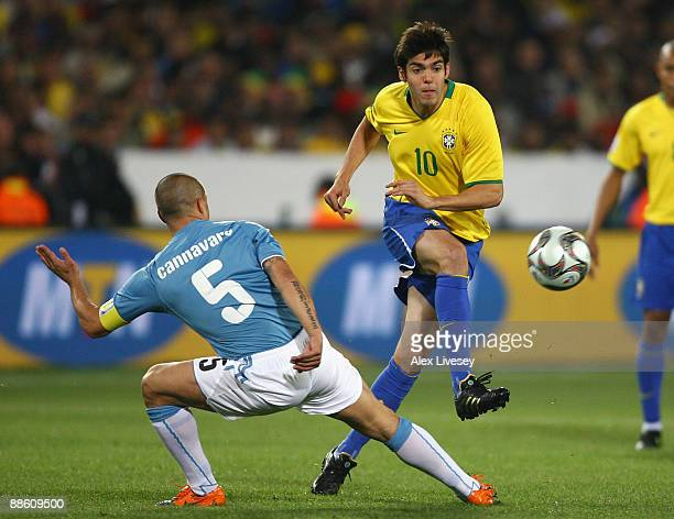 Kaka of Brazil passes the ball past Fabio Cannavaro of Italy during the FIFA Confederations Cup match between Italy and Brazil at the Loftus Versfeld...