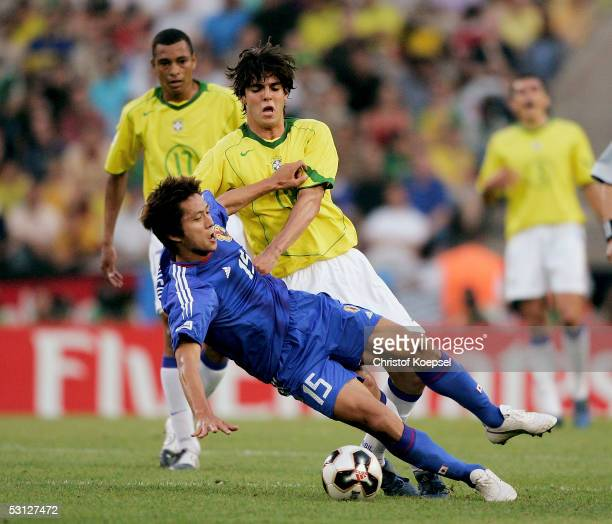 Kaka of Brazil pulls down Takashi Fukunishi of during the match between Japan and Brazil for the Confederations Cup 2005 at the RheinEnergie Stadium...
