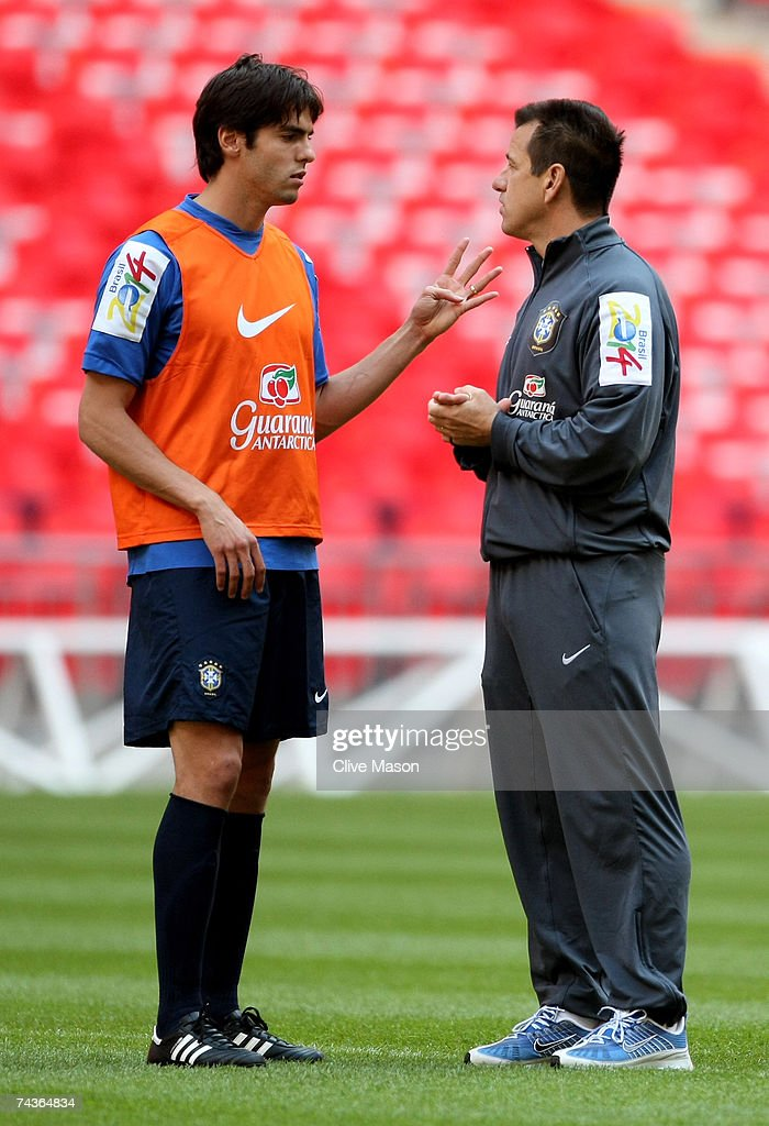 Kaka of Brazil talks to coach Dunga on the pitch during a training session ahead of the international friendly match between England and Brazil at...