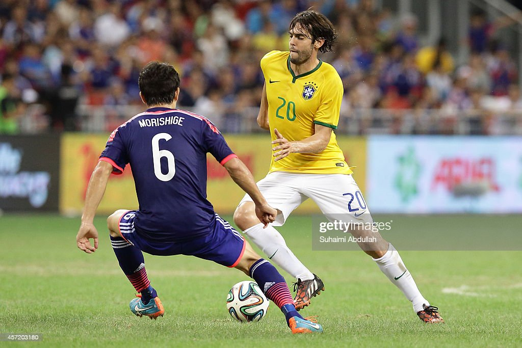 Kaka of Brazil (R) tries to dribble past <a gi-track='captionPersonalityLinkClicked' href=/galleries/search?phrase=Masato+Morishige&family=editorial&specificpeople=5351303 ng-click='$event.stopPropagation()'>Masato Morishige</a> of Japan during the international friendly match between Japan and Brazil at the National Stadium on October 14, 2014 in Singapore.