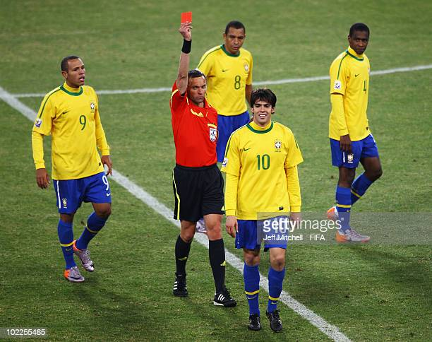 Kaka of Brazil walks off as he receives a red card from referee Stephane Lannoy during the 2010 FIFA World Cup South Africa Group G match between...