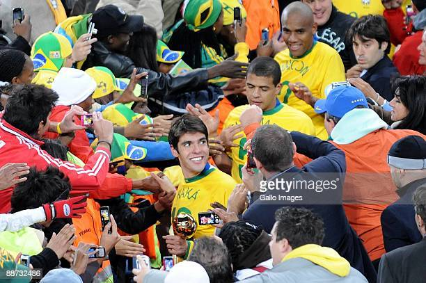 Kaka of Brazil with his teammates greet supporters after collecting their medals during the 2009 Confederations Cup final match between Brazil and...