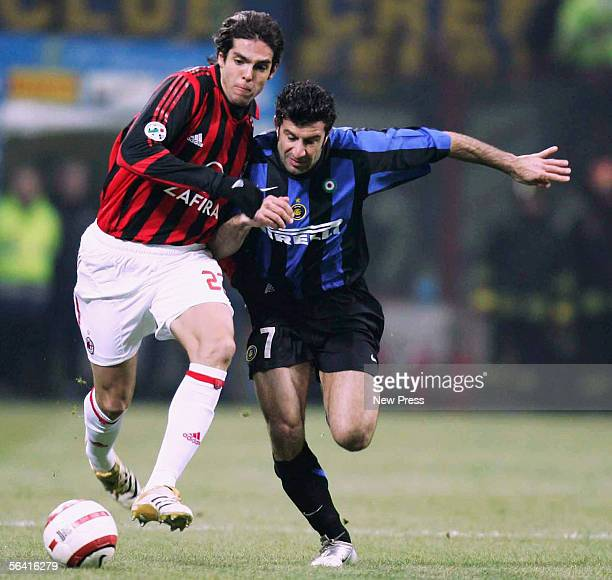 Kaka of Milan clashes with Luis Figo of Inter during the Serie A match between Inter Milan and AC Milan played at the Giuseppe Meazza San Siro...