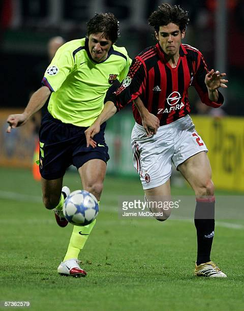 Kaka of Milan holds off Edmilson of Barcalona during the UEFA Champions League SemiFinal first leg between AC Milan and Barcelona at the Guiseppe...
