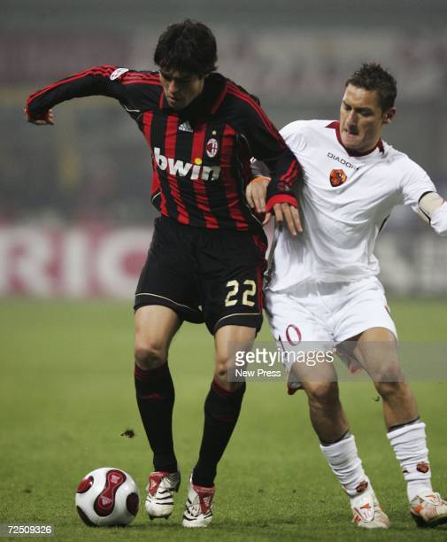 Kaka of Milan is challenged by Francesco Totti of Roma during the Serie A match between AC Milan and Roma at the Giuseppe Meazza Stadium on November...