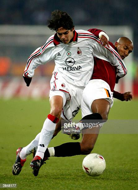 Kaka of Milan is tackled by Olivier Dacourt of Roma during the Serie A match between Roma and AC Milan at the Olympic Stadium on January 6 2004 in...