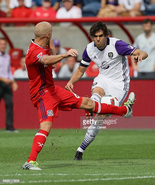 Kaka of Orlando City FC fires a shot past Eric Gehrig of Chicago Fire during an MLS match at Toyota Park on August 14 2016 in Bridgeview Illinois The...