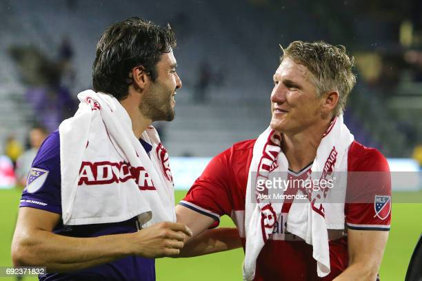 Kaka of Orlando City SC and Bastian Schweinsteiger of Chicago Fire speak at the conclusion of a MLS soccer match between the Chicago Fire and the...
