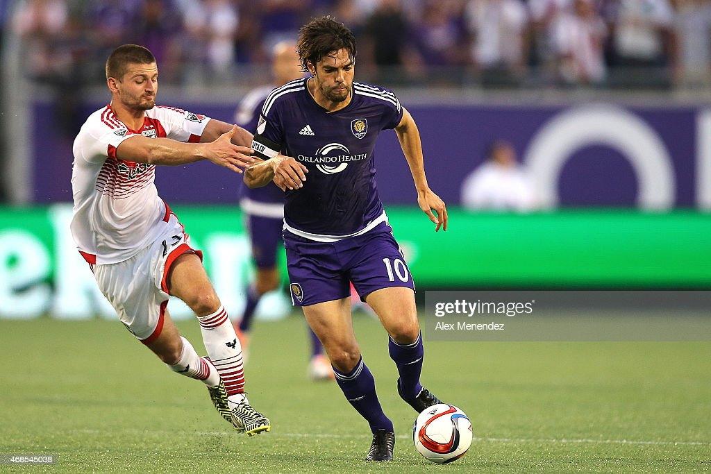 Kaka #10 of Orlando City SC and <a gi-track='captionPersonalityLinkClicked' href=/galleries/search?phrase=Perry+Kitchen&family=editorial&specificpeople=5005041 ng-click='$event.stopPropagation()'>Perry Kitchen</a> #23 of D.C. United fight for the ball during a MLS soccer match between DC United and the Orlando City SC at the Orlando Citrus Bowl on April 3, 2015 in Orlando, Florida.