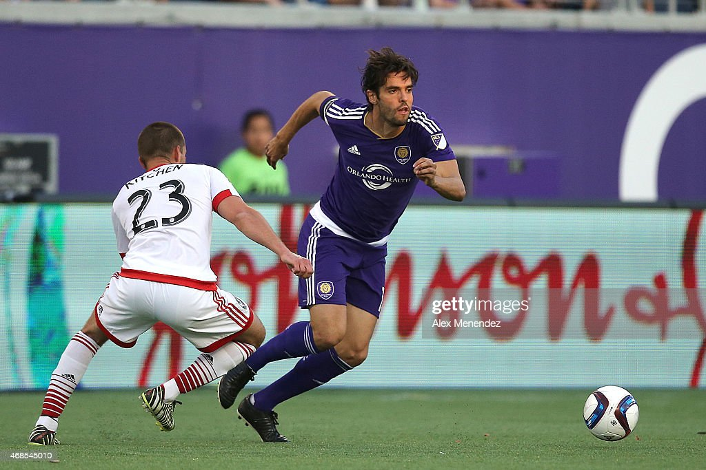 Kaka #10 of Orlando City SC dribbles past Perry Kitchen #23 of D.C. United during a MLS soccer match between DC United and the Orlando City SC at the Orlando Citrus Bowl on April 3, 2015 in Orlando, Florida.
