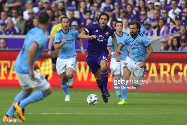 Kaka of Orlando City SC runs past RJ Allen of New York City FC and Andrea Pirlo of New York City FC during a MLS soccer match between New York City...