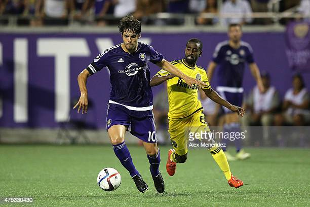 Kaka of Orlando City SC runs with the ball in front of Mohammed Saeid of Columbus Crew during a MLS soccer match between the Columbus Crew and the...