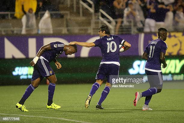 Kaka of Orlando City SC taps Cyle Larin of Orlando City SC on the head after he scored a goal during a MLS soccer match between the Chicago Fire and...