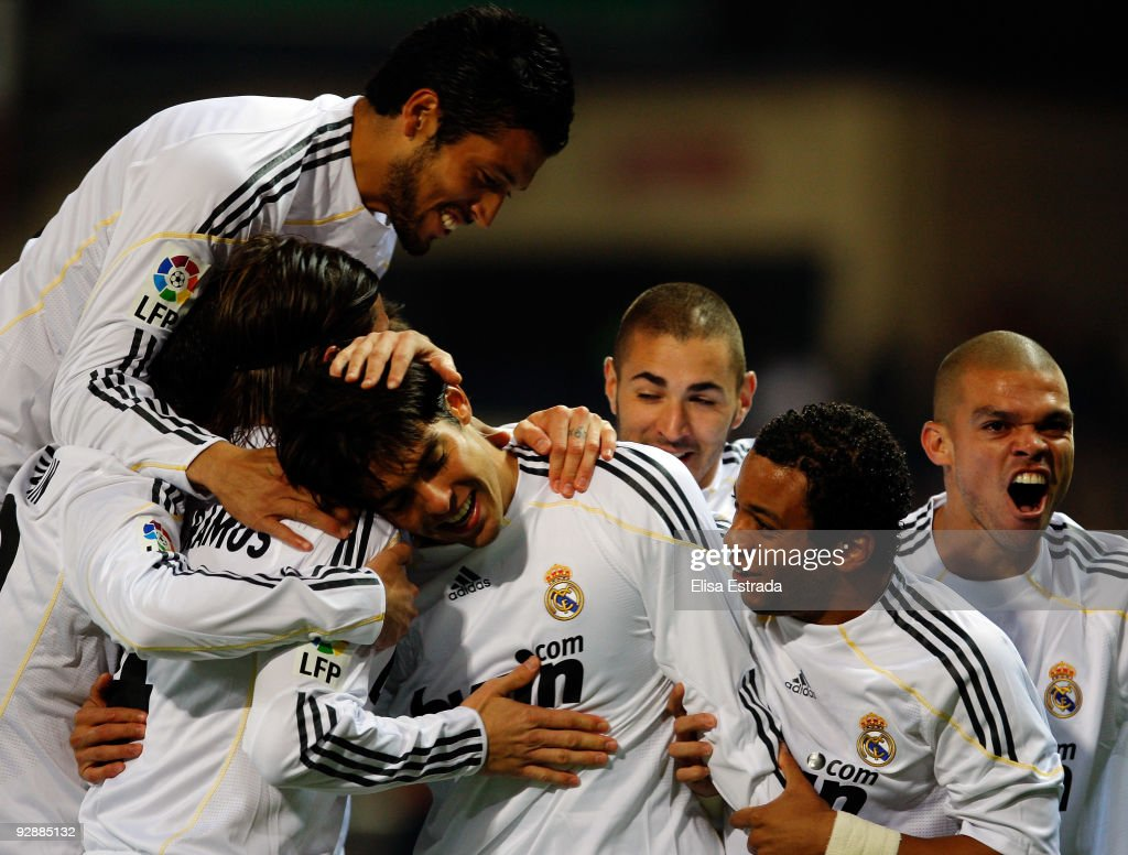 Kaka (C) of Real Madrid celebrates his goal with his team mates <a gi-track='captionPersonalityLinkClicked' href=/galleries/search?phrase=Ezequiel+Garay&family=editorial&specificpeople=857797 ng-click='$event.stopPropagation()'>Ezequiel Garay</a> (L), Marcelo (2nd R) and Pepe (R) during the La Liga match between Atletico Madrid and Real Madrid at Vicente Calderon Stadium on November 7, 2009 in Madrid, Spain.