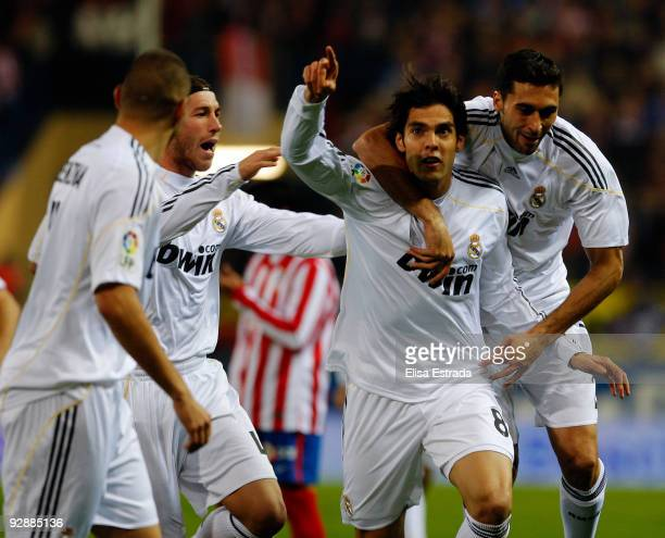 Kaka of Real Madrid celebrates his goal with Sergio Ramos and Alvaro Arbeloa during the La Liga match between Atletico Madrid and Real Madrid at...