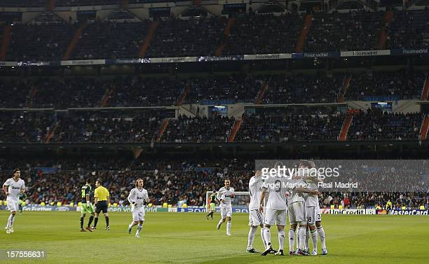 Kaka of Real Madrid celebrates with team mates after scoring Real's third goal during the UEFA Champions League Group D match between Real Madrid and...