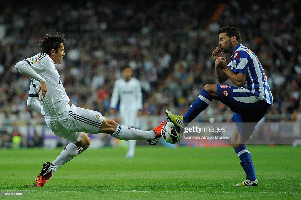 Kaka of Real Madrid CF runs for the ball with <a gi-track='captionPersonalityLinkClicked' href=/galleries/search?phrase=Bruno+Gama&family=editorial&specificpeople=2251634 ng-click='$event.stopPropagation()'>Bruno Gama</a> of RC Deportivo La Coruna during the La Liga match between Real Madrid CF and RC Deportivo La Coruna at Bernabeu on September 30, 2012 in Madrid, Spain.