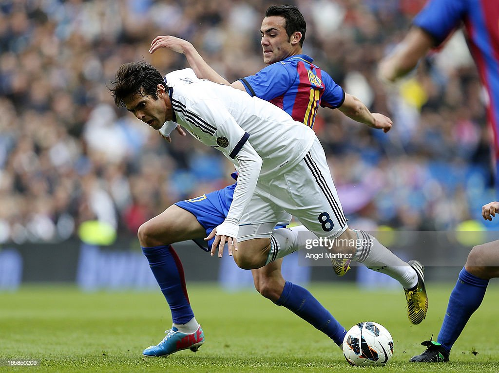 Kaka of Real Madrid competes for the ball with Vicente Iborra of Levante during the La Liga match between Real Madrid and Levante at Estadio Santiago Bernabeu on April 6, 2013 in Madrid, Spain.