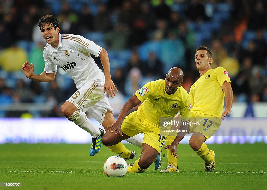 Kaka (L) of Real Madrid duels for the ball with Marcos Senna (C) and Javier Camunas of Villarreal during the la Liga match between Real Madrid and Villarreal at the Estadio Santiago Bernabeu on October 26, 2011 in Madrid, Spain.