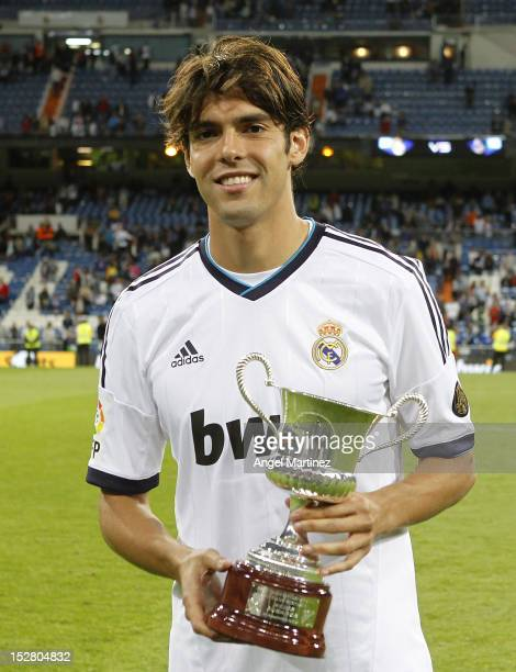 Kaka of Real Madrid holds his man of the match trophy after winning the Santiago Bernabeu Trophy match between Real Madrid and Millonarios CF at...