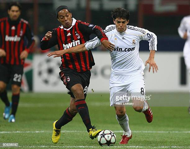Kaka of Real Madrid holds off a challenge from Ronaldinho of AC Milan during the UEFA Champions League Group C match between AC Milan and Real Madrid...