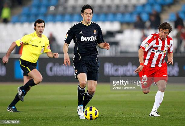 Kaka of Real Madrid is chased by Hernan Bernardello of Almeria during the La Liga match between UD Almeria and Real Madrid at Estadio del...