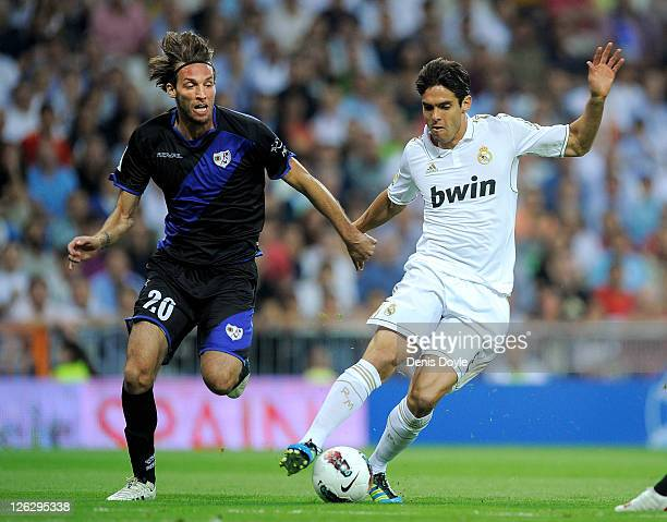 Kaka of Real Madrid is tackled by Michu of Rayo Vallecano during the La Liga match between Real Madrid and Rayo Vallecano at Estadio Santiago...