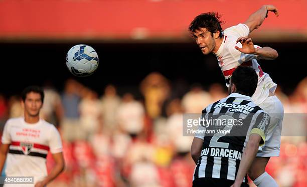 Kaka of Sao Paulo fights for the ball with Edu Dracena of Santos during the match between Sao Paulo and Santos for the Brazilian Series A 2014 at...