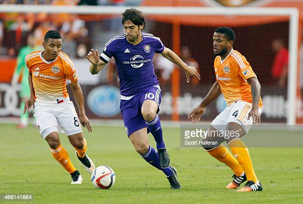 Kaka of the Orlando City SC moves with the ball between Luis Garrido and Jermaine Taylor of the Houston Dynamo during their game at BBVA Compass...
