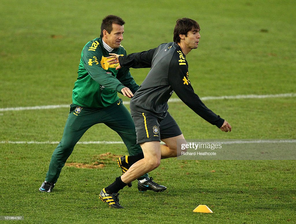 Kaka tries to hold off Head Coach Dunga during the Brazil team training session at Randburg School on June 11 2010 in Johannesburg South Africa The...