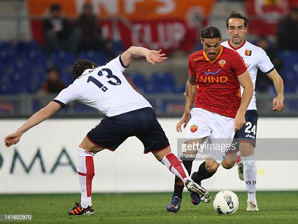 Kakha Kaladze of Genoa CFC competes for the ball with Daniel Osvaldo of AS Roma during the Serie A match between AS Roma and Genoa CFC at Stadio...