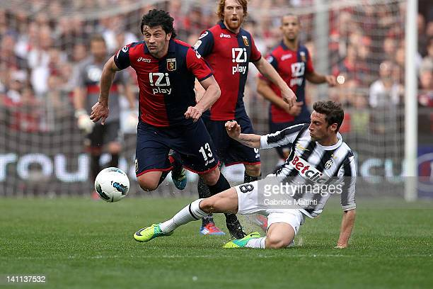 Kakha Kaladze of Genoa CFC fights for the ball with Claudio Marchisio of Juventus FC during the Serie A match between Genoa CFC and Juventus FC at...
