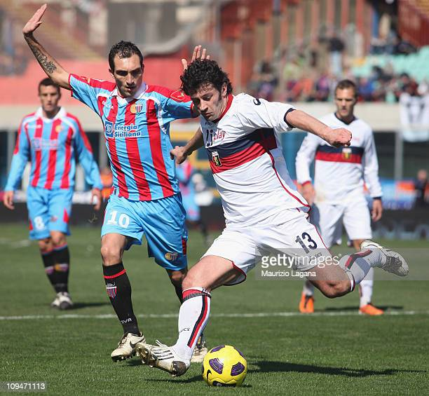 Kakha Kaladze of Genoa is challengerd by Francesco Lodi of Catania during the Serie A match between Catania Calcio and Genoa CFC at Stadio Angelo...