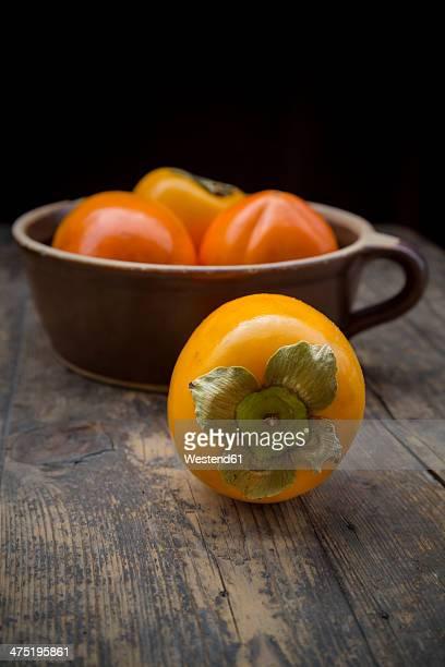Kaki fruits in ceramic pot