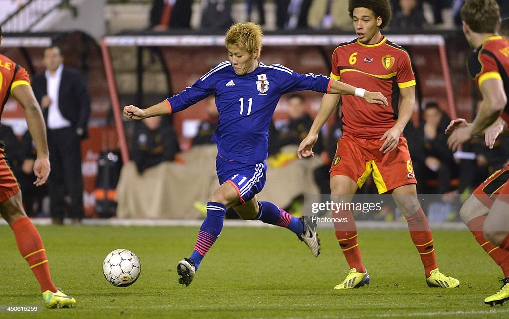 Kakitani Yoichiro of Cerezo Osaka (Japan) - Axel Witsel of FC Zenit St-Petersburg pictured during the pre World Cup international friendly match between Belgium and Japan on November 19, 2013 in Brussels, Belgium