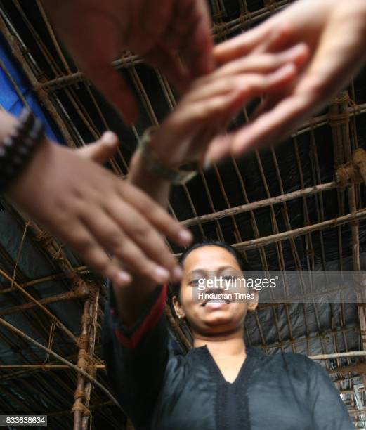 Kala Krishnan the commerce topper from NM College Vile Parle shakes hands with her friends