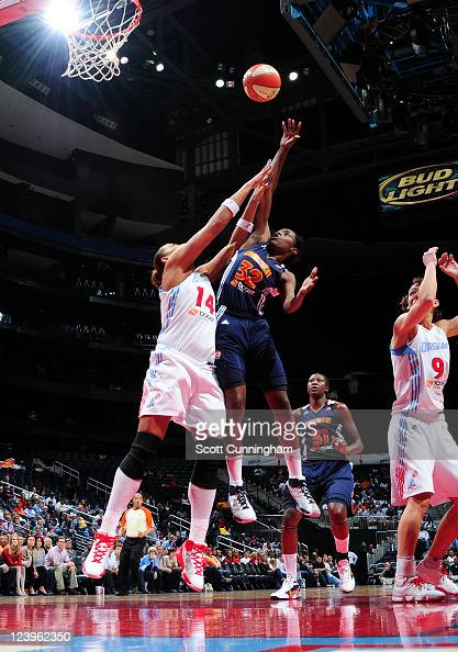Kalana Greene of the Connecticut Sun puts up a shot against Erika deSouza of the Atlanta Dream at Philips Arena on September 6 2011 in Atlanta...