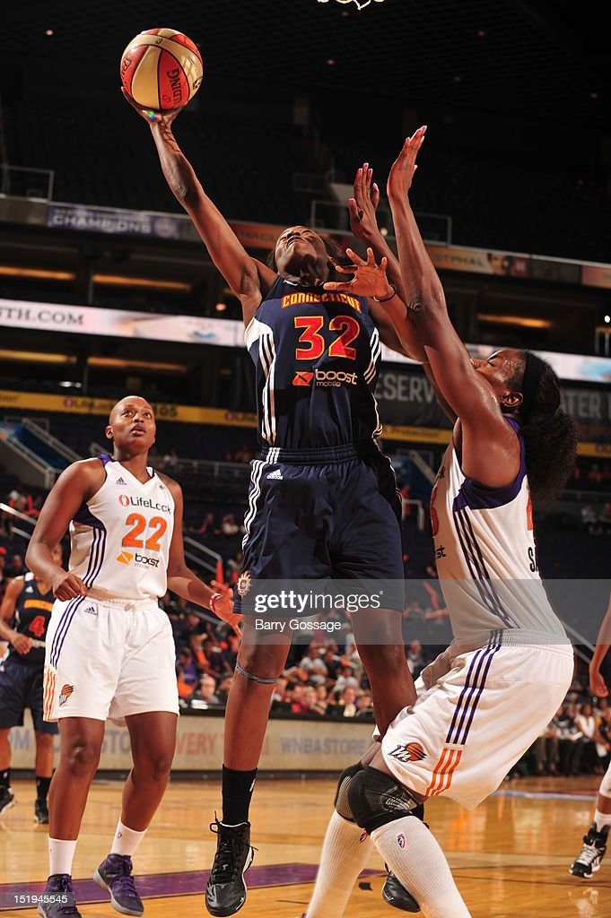 Kalana Greene of the Connecticut Sun shoots against Nakia Sanford of the Phoenix Mercury on September 12 2012 at US Airways Center in Phoenix Arizona...