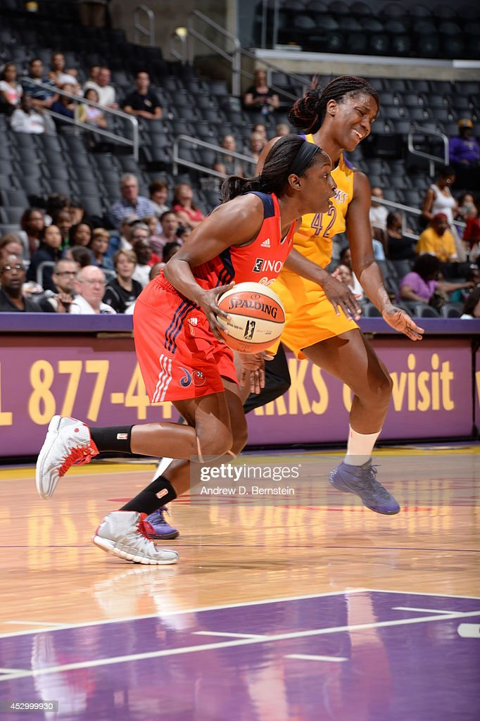 <a gi-track='captionPersonalityLinkClicked' href=/galleries/search?phrase=Kalana+Greene&family=editorial&specificpeople=4128747 ng-click='$event.stopPropagation()'>Kalana Greene</a> #23 of the Washington Mystics drives against the Los Angeles Sparks at STAPLES Center on July 17, 2014 in Los Angeles, California.