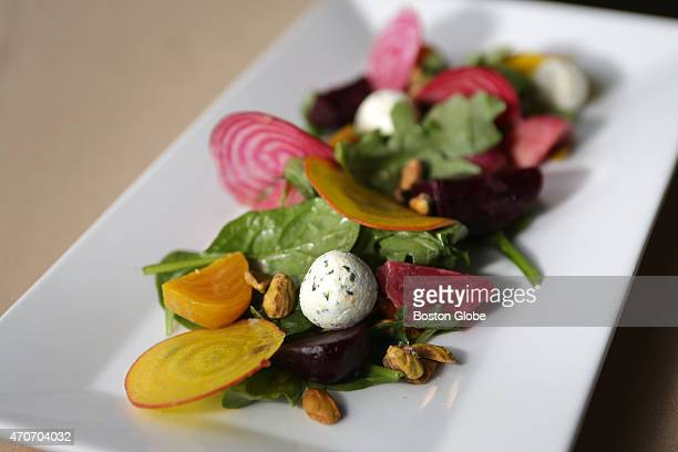 A kale golden beet golden raison Vermont goat cheese pistachio salad at EMC Club at Fenway Park Some of the ingredients were grown in Fenway Farms...