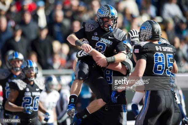 Kale Pearson of the Air Force Falcons celebrates after a 9yard touchdown run against the Rice Owls during the Bell Helicopter Armed Forces Bowl on...