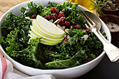 Kale salad with dried cranberry, almonds and apple