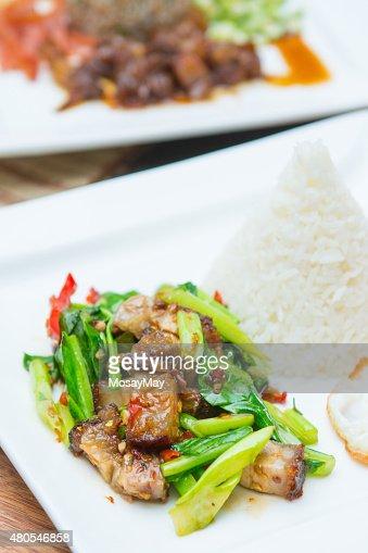 Ravizzone con di suino croccante e riso : Foto stock