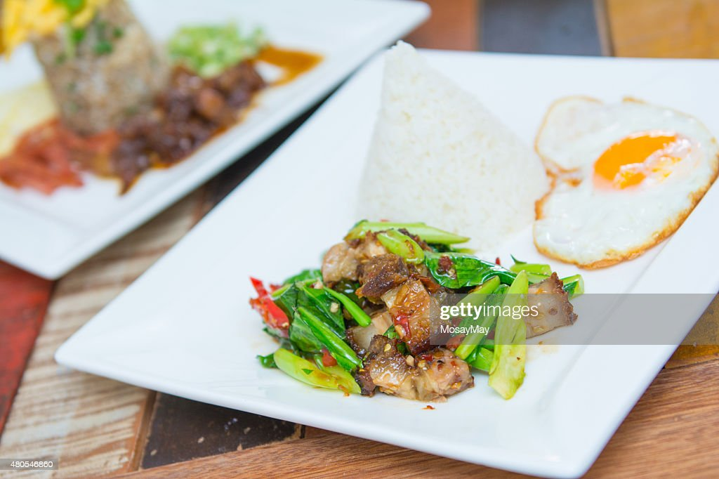 Kale with crispy pork and rice : Stock Photo