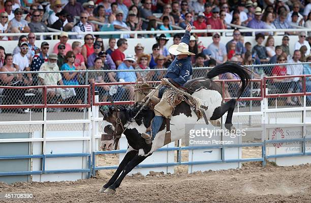 Kaleb Asay competes in the Saddle Bronc Riding at the Prescott Frontier Days 'World's Oldest Rodeo' on July 4 2014 in Prescott Arizona