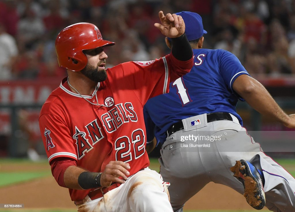 Kaleb Cowart #22 of the Los Angeles Angels of Anaheim is safe at third base in the fourth inning against Elvis Andrus #1 of the Texas Rangers at Angel Stadium of Anaheim on August 22, 2017 in Anaheim, California.