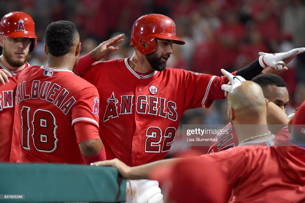 Kaleb Cowart #22 of the Los Angeles Angels of Anaheim returns to the dugout after hitting a three-run home run in the fifth inning against the Texas Rangers at Angel Stadium of Anaheim on August 22, 2017 in Anaheim, California.