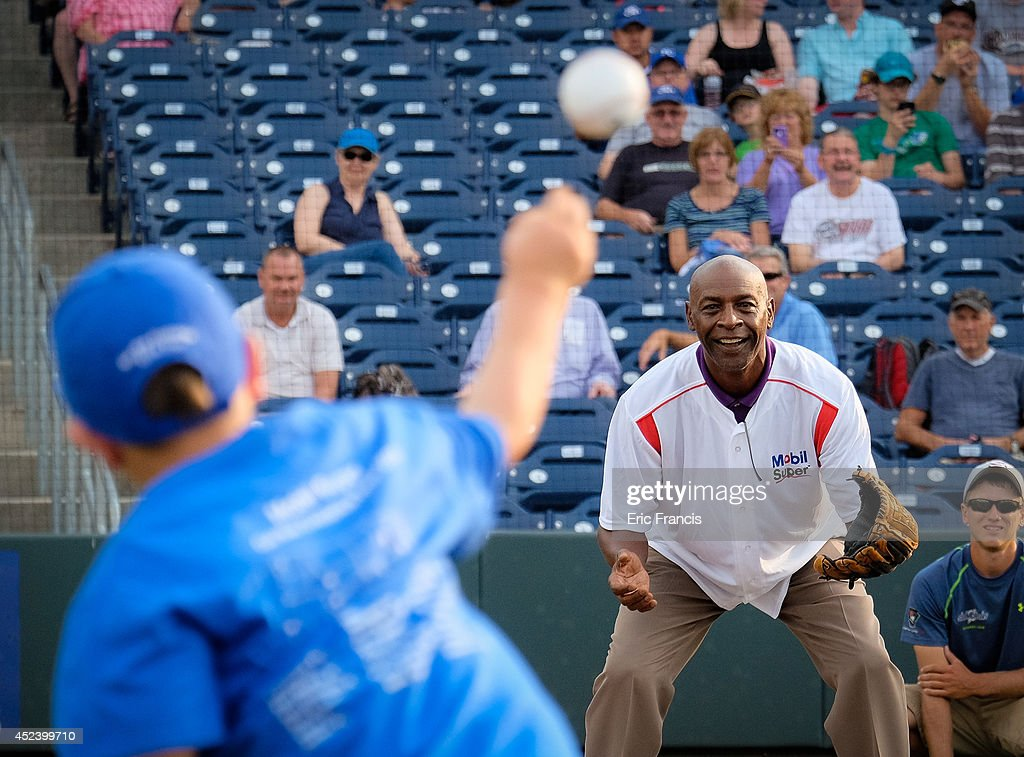 Kaleb Seffron throws out the first pitch to Two-time All-Star, two-time Silver Slugger Award winner and 1985 World Series Champion <a gi-track='captionPersonalityLinkClicked' href=/galleries/search?phrase=Willie+Wilson+-+Baseball+Player&family=editorial&specificpeople=241493 ng-click='$event.stopPropagation()'>Willie Wilson</a> as part of the Mobil Super 'Go the Distance' Baseball Tour on July 19, 2014 in Omaha, Nebraska.