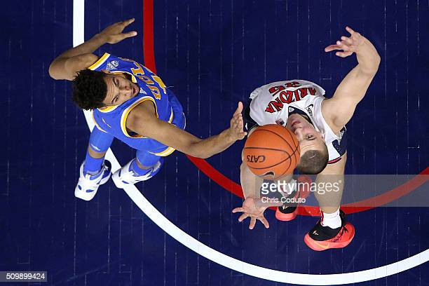 Kaleb Tarczewski of the Arizona Wildcats and Jonah Bolden of the UCLA Bruins fight for a rebound during the second half of the college basketball...